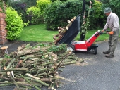 Electric Wheelbarrow moving & tipping logs