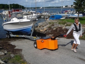 HD Trailer Mover towing boat trailer up slipway in Sweden