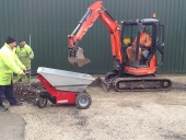 Electric Barrow being loaded by mini digger