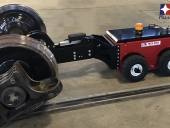 MUV 4WD radio-controlled Electric Tug with grab attachment pulling a wheel set in a rail dept