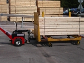 Power Pusher moving 2,500Kg timber trolley in sawmill