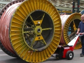 Power Pusher, cable drum pusher, pushing 9,000Kg cable drum at Prysmian Cables.