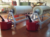 PowerTugs moving Fabric roll trolleys