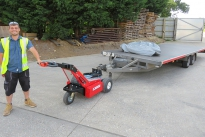 MUV Trailer Mover pulling a twin axle flatbed trailer