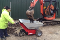 MUV - Electric Wheelbarrow being loaded by mini digger