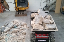 MUV Electric Wheelbarrow loaded with broken concrete