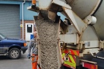 Loading MUV Electric Wheelbarrow with concrete from delivery lorry