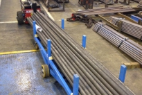 Power Pusher moving steel pipe trolleys