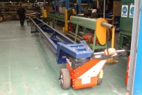 Power Pusher with integrated trolley for moving steel bar