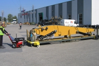 Power Pusher with Steering Arm moving excavator boom on mobile stillage