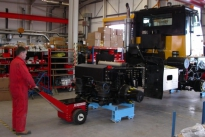 Power Pusher moving Off-Highway vehicle chassis on skates along production line