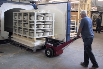 Power Pusher with Steering Arm moving kiln trolleys at Churchill China plc