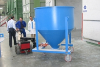 Power Pusher moving polymer granule bin