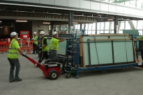 Power Pusher with Steering Arm moving stillages at Heathrow T5 construction