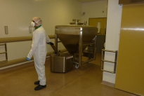 Stainless Steel PowerTug moving Pharma mixing vessel in clean room