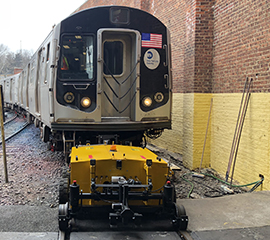 Railcar Mover moving a NYC Subway Carriage