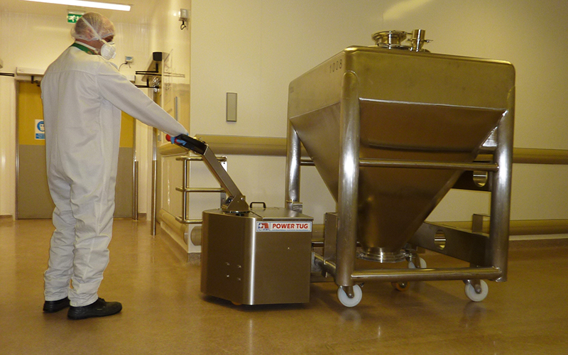 Stainless Steel PowerTug moving Pharmaceutical mixing vessel with 4 swivel castors at GSK